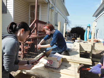 Volunteers working on a wheel chair ramp